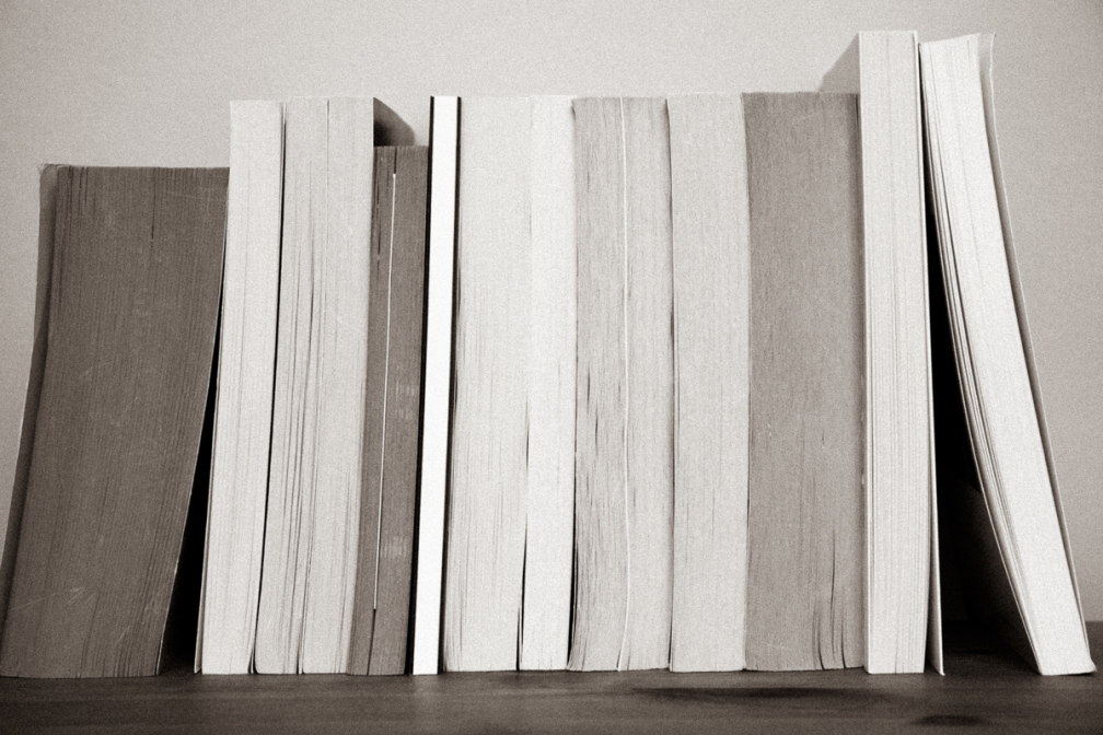Book shelf, books with pages showing.